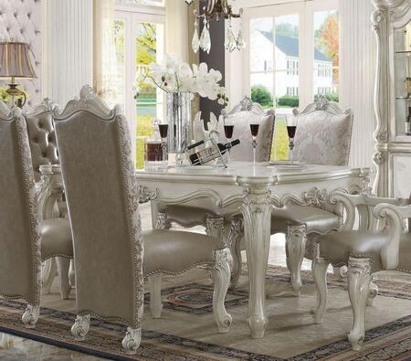 Versailles Collection 61140 71 inch  Dining Table with Scrolled Legs  Carved Apron  Poly Resin Decor