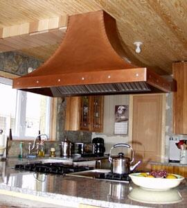 RangeCraft  CMHRCURVETTE Island Mount Range Hood Custom Color, Shown in Antique Copper with Decorative Stainless Steel Buttons on Trim