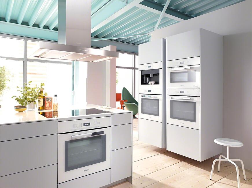 The ovens in this picture are the Miele H6880BPBRWS Wall Ovens in one of their latest finishes: Brilliant White. This is a top pick of an all white, modern kitchen. The appliances melt into sleek all white cabinetry for a sleek look.